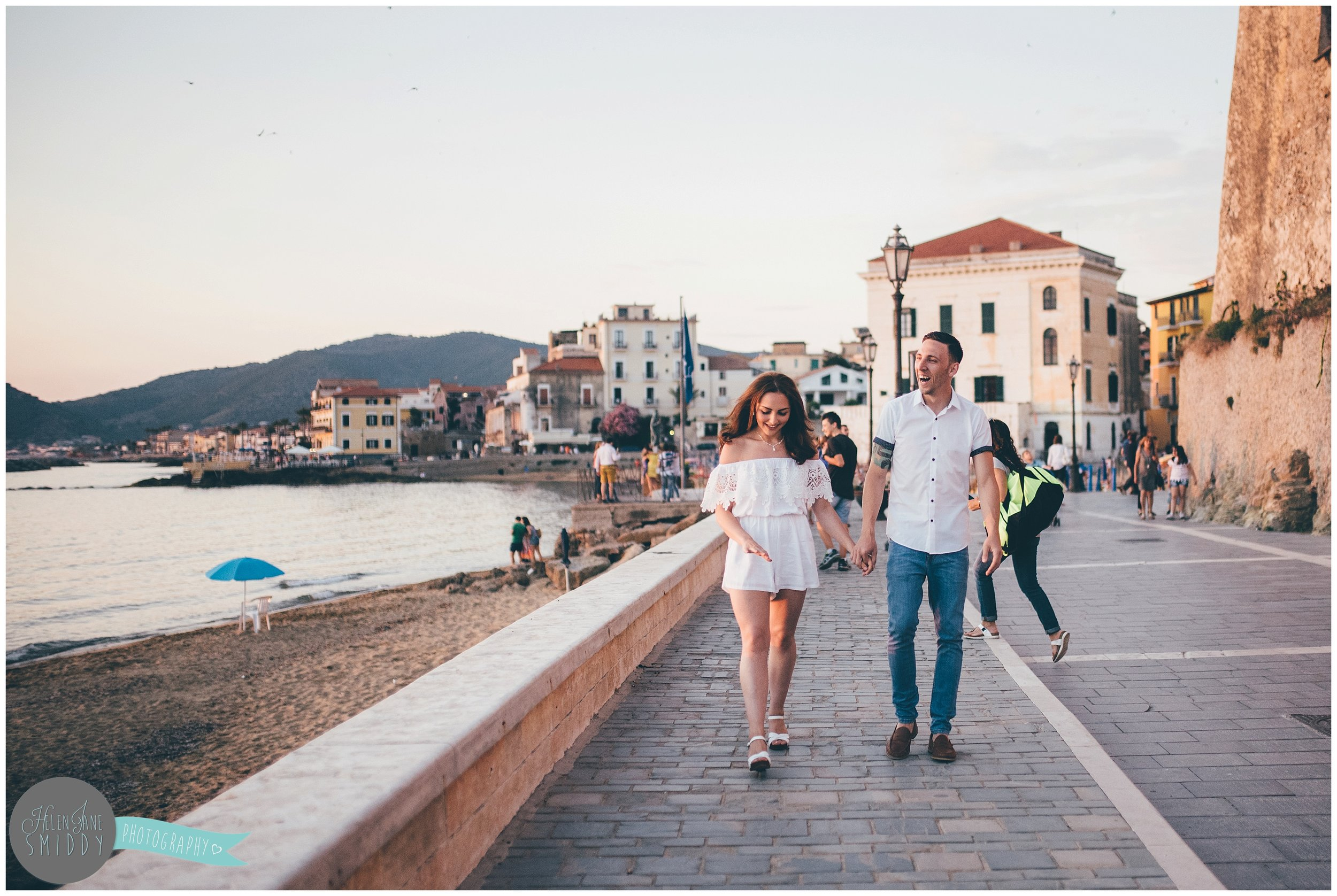 The young couple stroll through the rustic streets during their Engagement photoshoot in Santa Maria Di Castellabate, Italy.