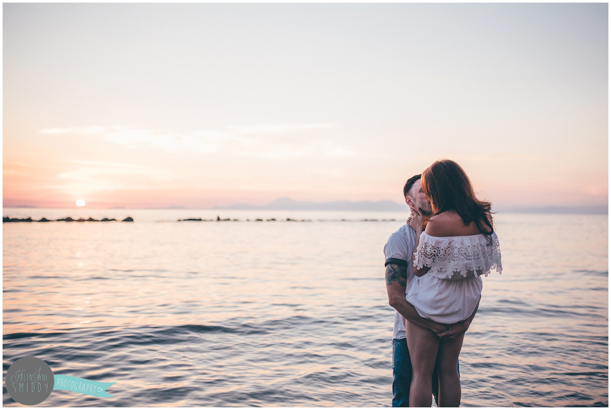 Sabrina and Dom kiss on the beach at sunset in Santa Maria di Castellabate for their pre-wedding photoshoot.