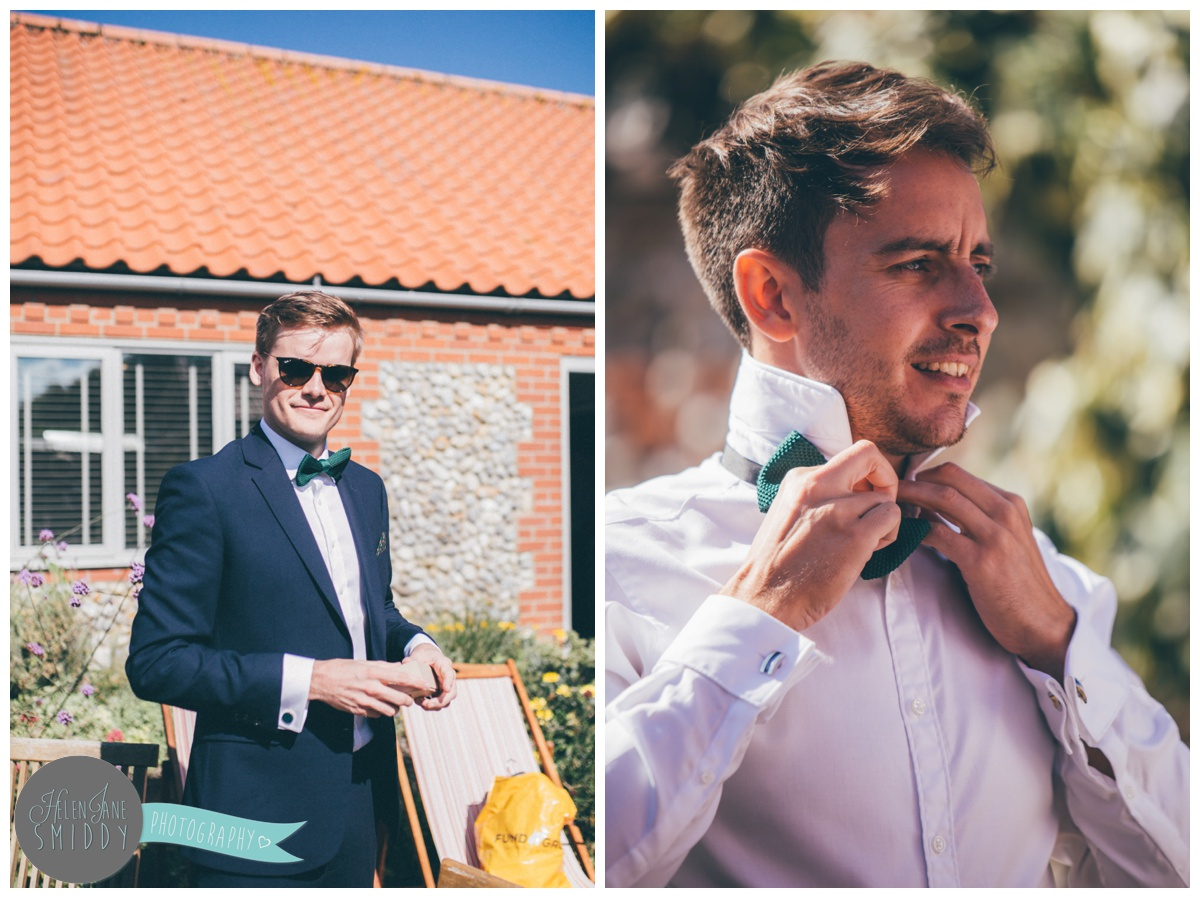 The groom stands smiling before saying his I Do's in Mason's Yard, Norfolk.