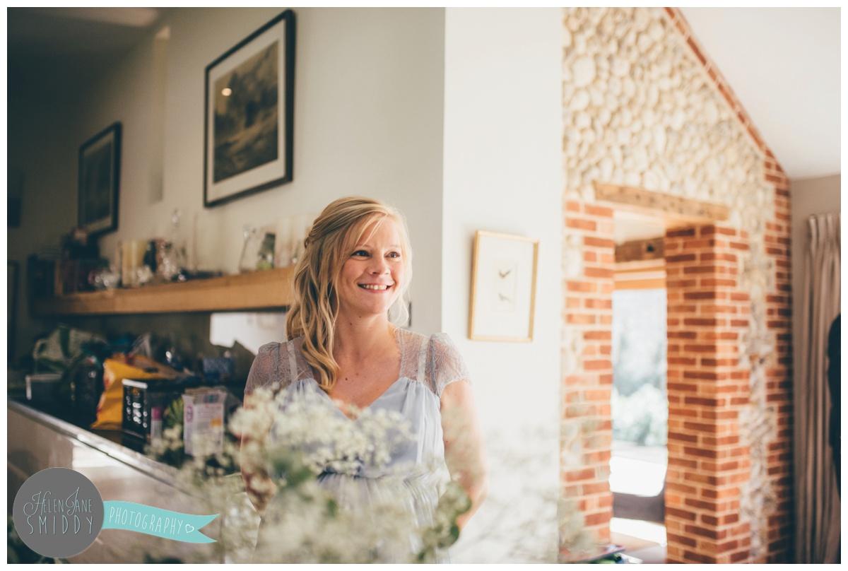 Beautiful, blooming pregnant bridesmaid at Barn Drift in Norfolk.