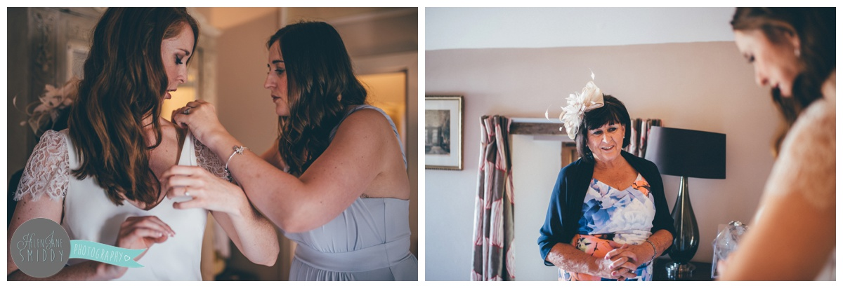 Bridesmaid puts finishing touches on her friend.