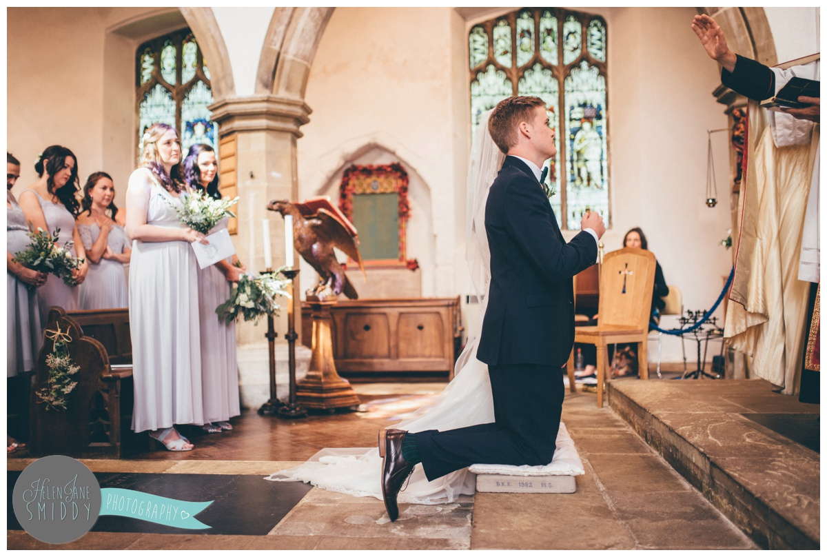 Bride and groom in church in Norfolk after their beautiful ceremony.