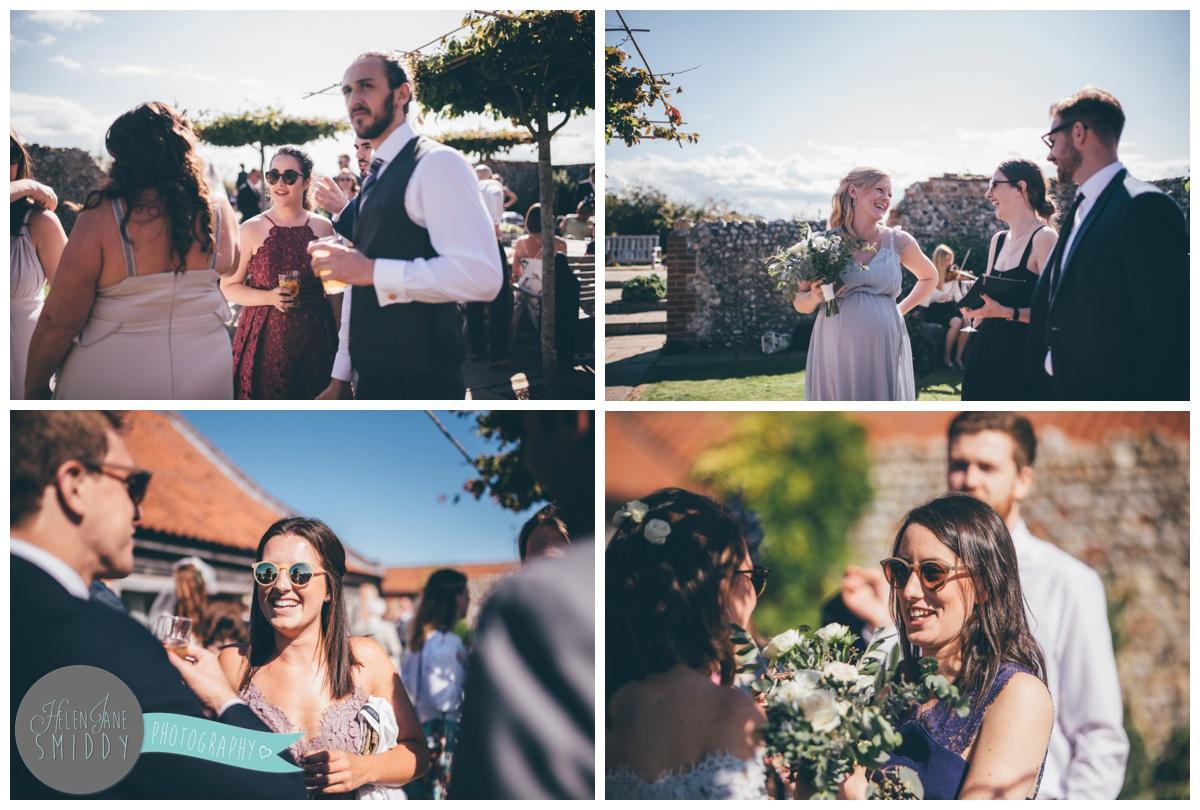 Guests enjoying the sun at a beautiful September wedding at Barn Drift in Norfolk.