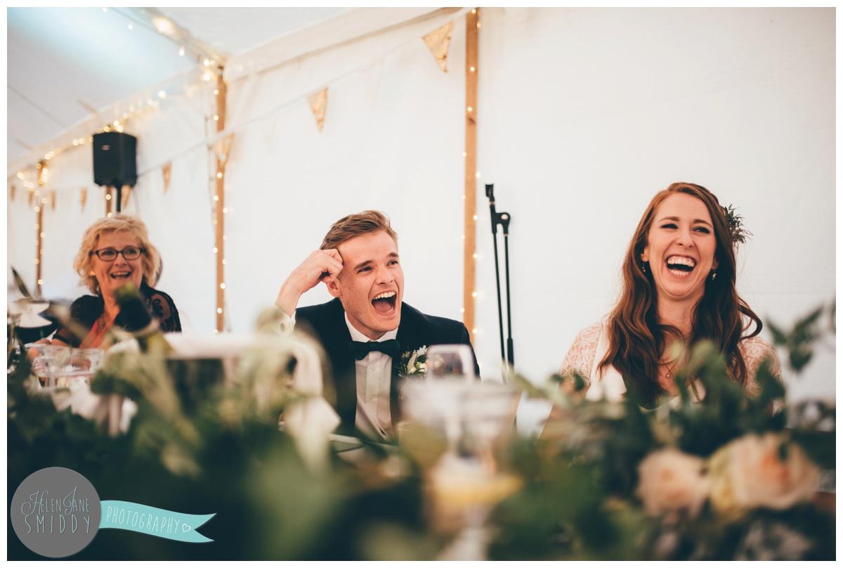 Wedding speeches shot by Cheshire wedding photographer at Barn Drift in Norfolk.