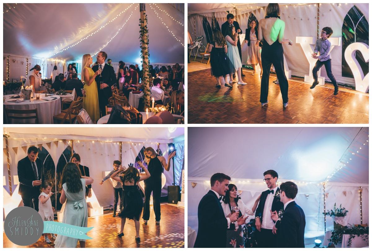Wedding guests dancing at Barn Drift in Norfolk.