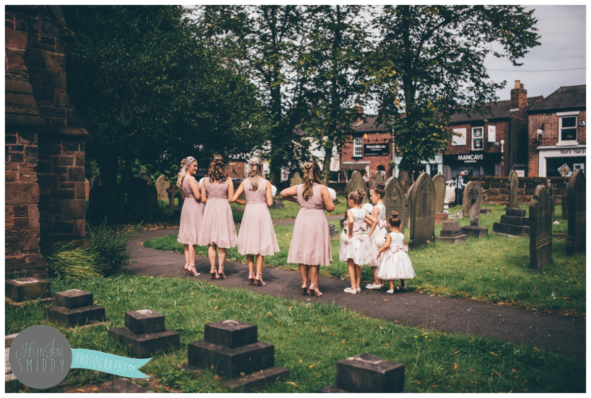The bridesmaids wait outside the church in Stockton Heath for the bride to arrive.