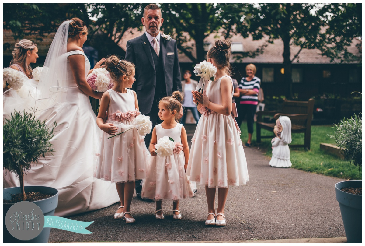 The bridal party wait outside the church doors in Stockton Heath.