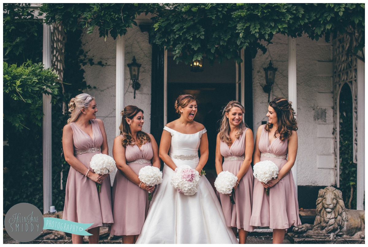 The bride and her beautiful bridesmaids enjoying the Big Day.