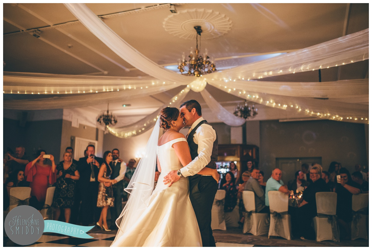 The newlyweds share a kiss during their First Dance at Statham Lodge in Cheshire.