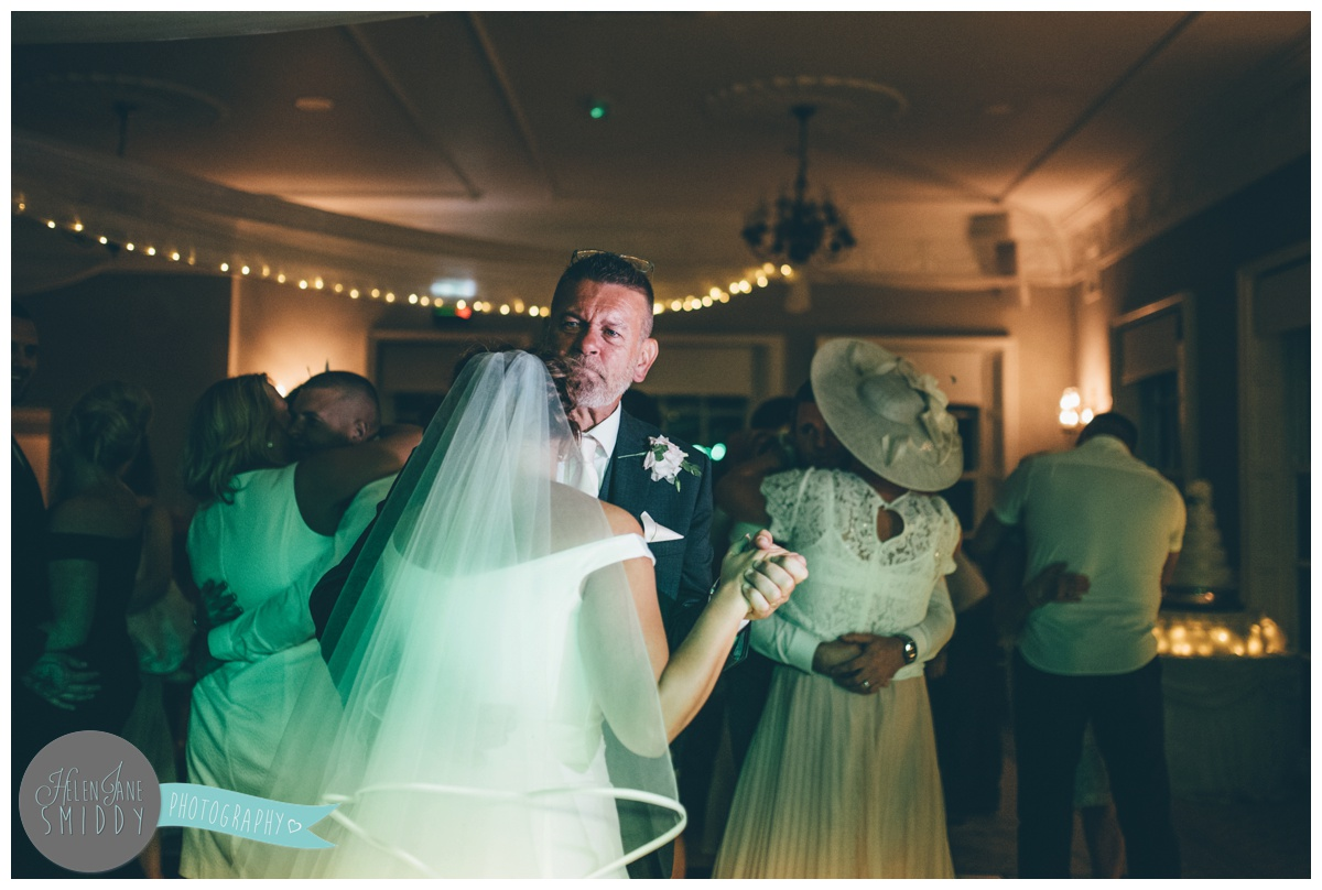 The bride has an emotional first dances with her Dad at Statham Lodge in Cheshire.