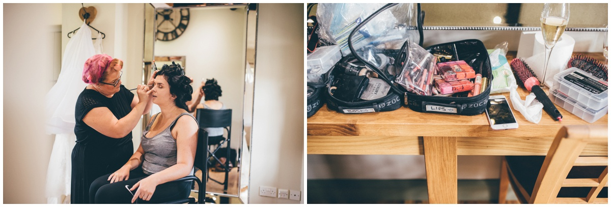 The beautiful bride, Amy, gets her make-up done in the bridal suite at The Ashes wedding barn in Staffordshire.