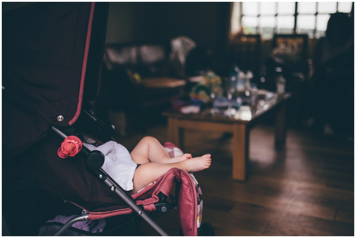 Cute sleeping flowergirl before the wedding ceremony at The Ashes wedding barn in Staffordshire.