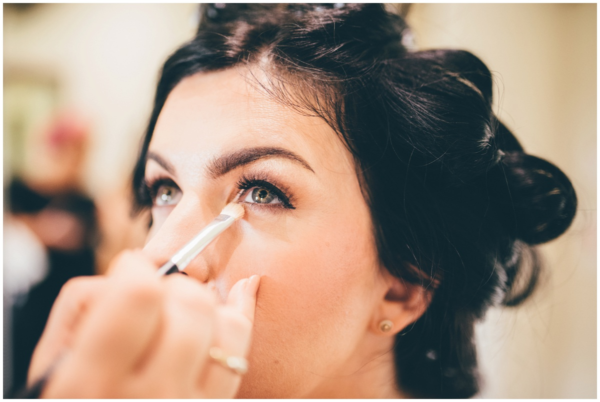 The beautiful bride getting her make-up done on the morning of her wedding at The Ashes wedding barn in Staffordshire.
