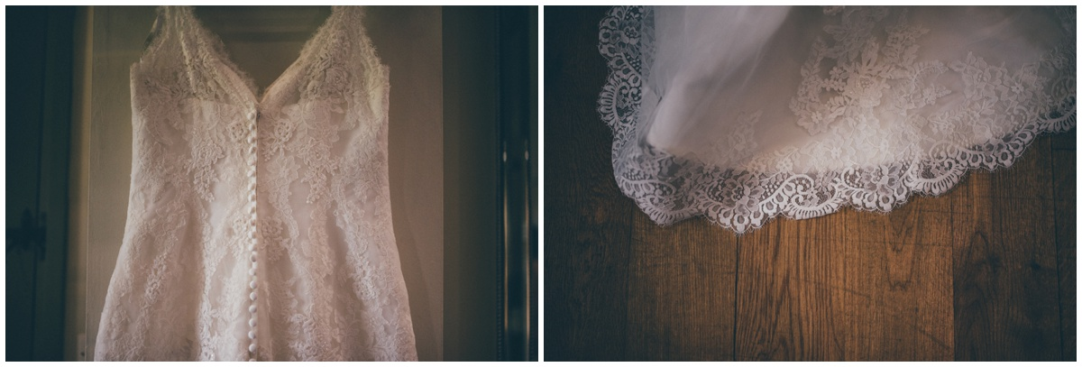 The pretty lace wedding gown hung up in the bridal suite at The Ashes wedding barn in Staffordshire.