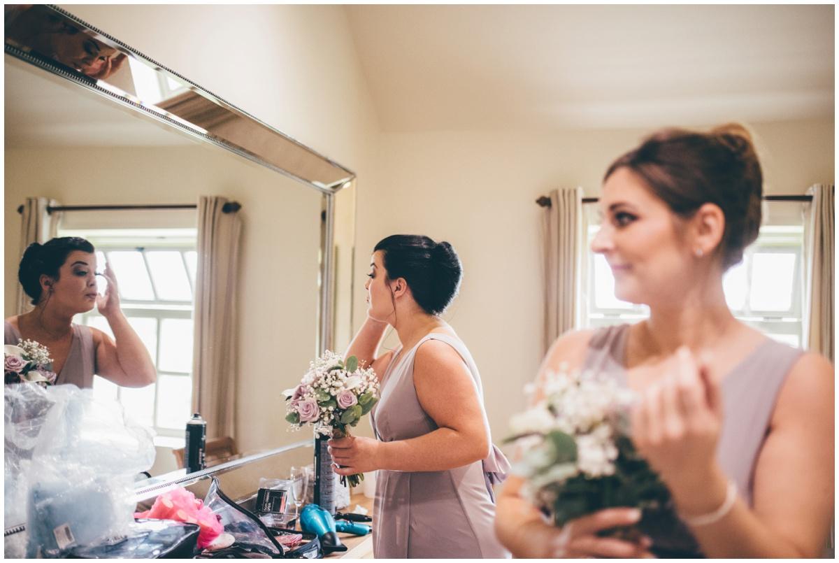 Bridesmaid checks out her wedding make-up.