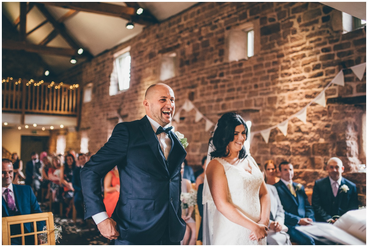 The bride and groom take their vows at The Ashes wedding barn in Staffordshire.