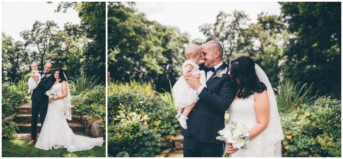The bride and groom and their little girl  at The Ashes wedding barn in Staffordshire.
