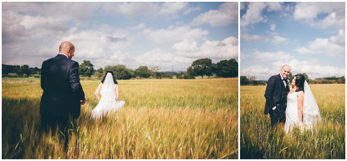 The newyleds walk through cornfields for their wedding portraits at The Ashes wedding barn in Staffordshire.