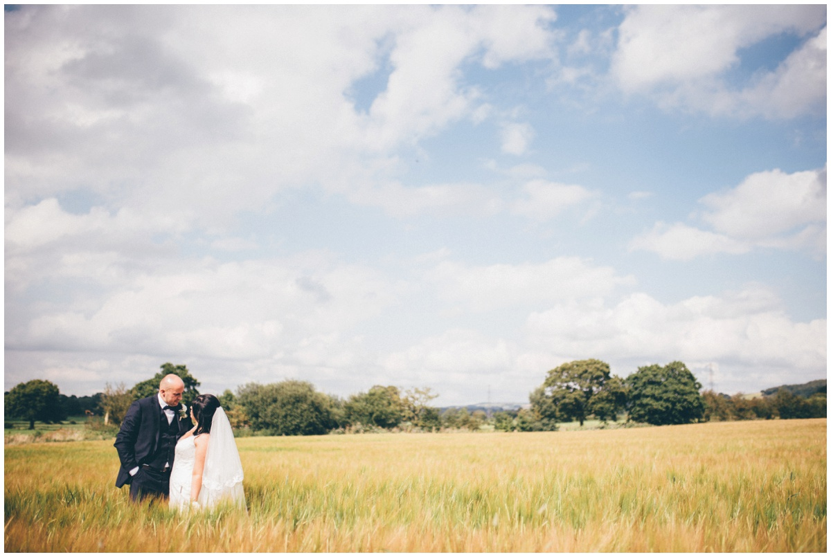 The new husband and wife stare lovingly at each other, at The Ashes wedding barn in Staffordshire.