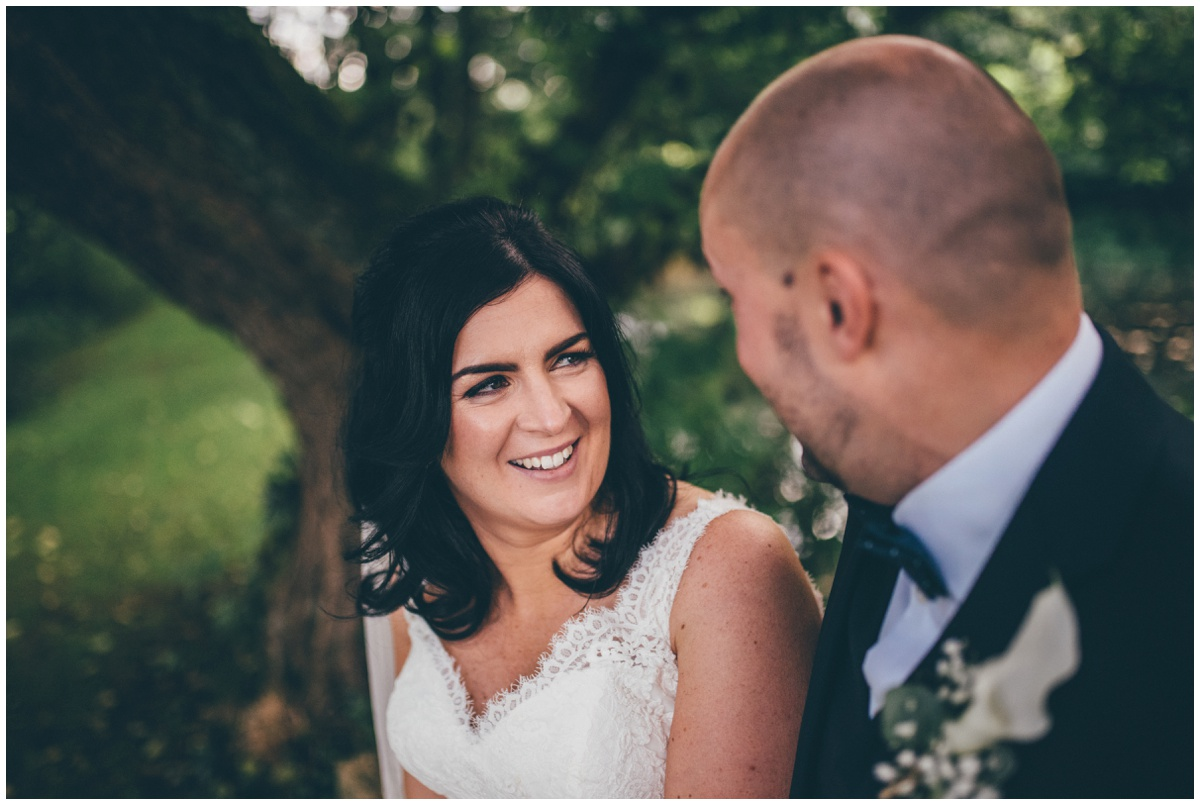 The bride laughs with her new husband at The Ashes wedding barn in Staffordshire.