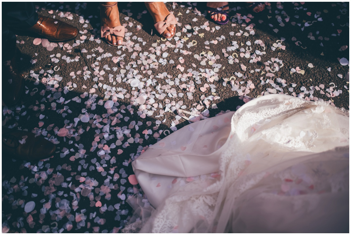 The confetti sits prettily on the floor at The Ashes wedding barn in Staffordshire.