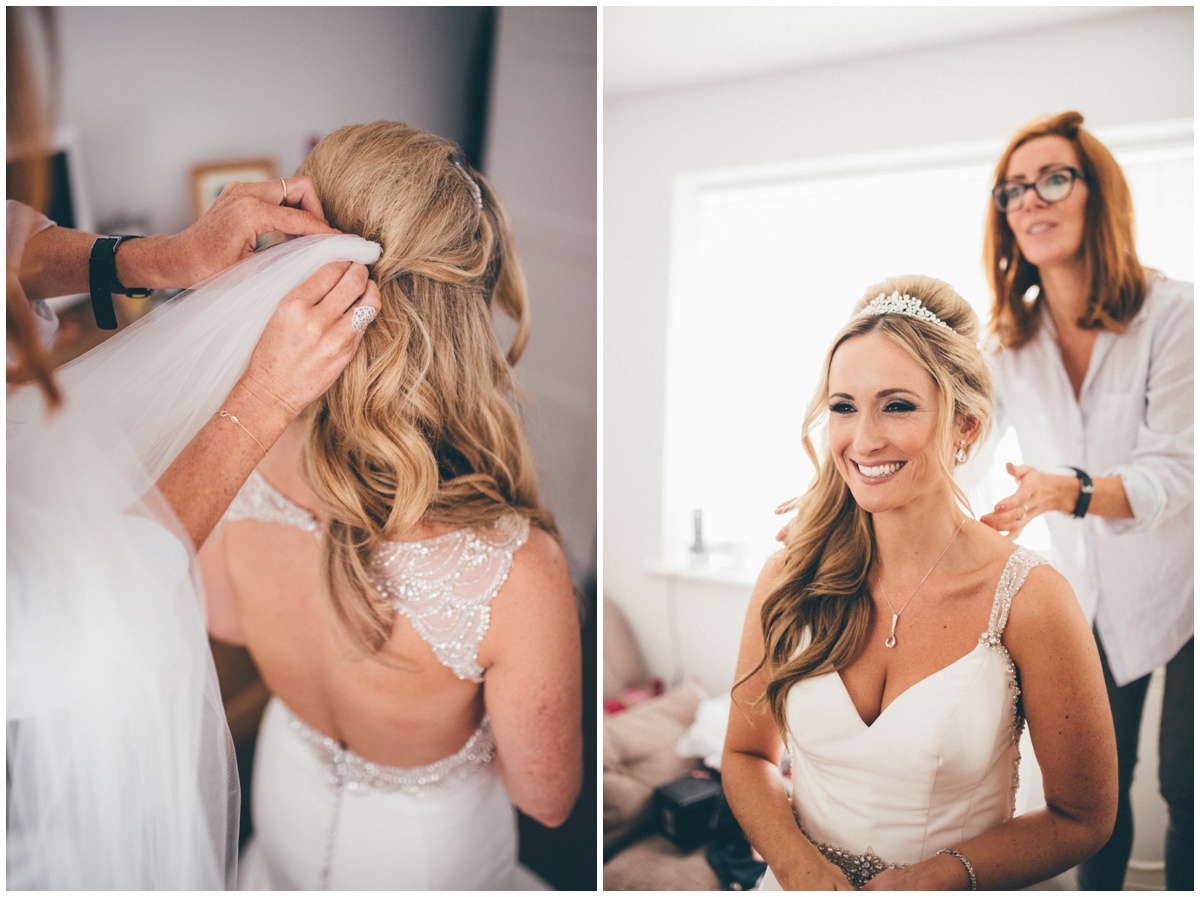 The make-up artist puts the bride's veil in before the ceremony.