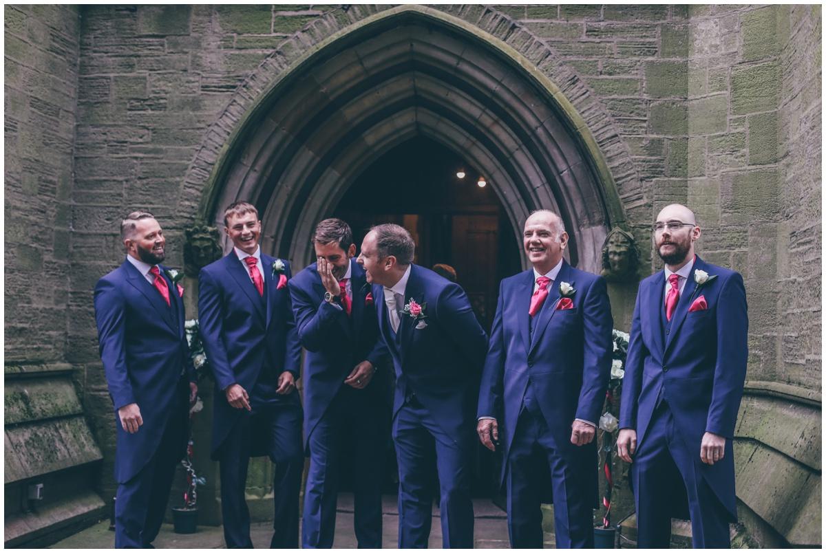 Groomsmen all share a joke outside St Mark's Church in Worsley.