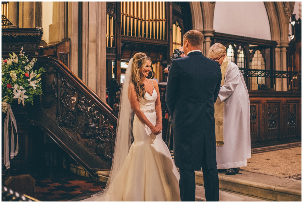 The bride and groom say their I Do's at St Mark's Church in Worsley.