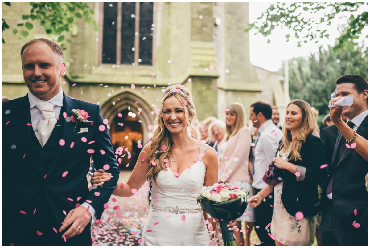 Beautiful and colourful confetti thrown over the bride and groom outside St Mark's Church in Worsley.