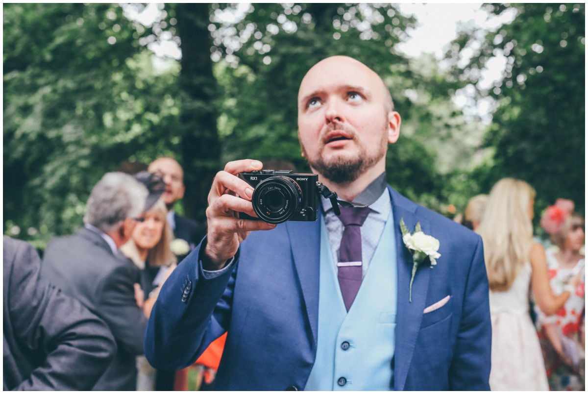 Manchester photographer rolls his eyes as the wedding photographer tries to take his photograph.