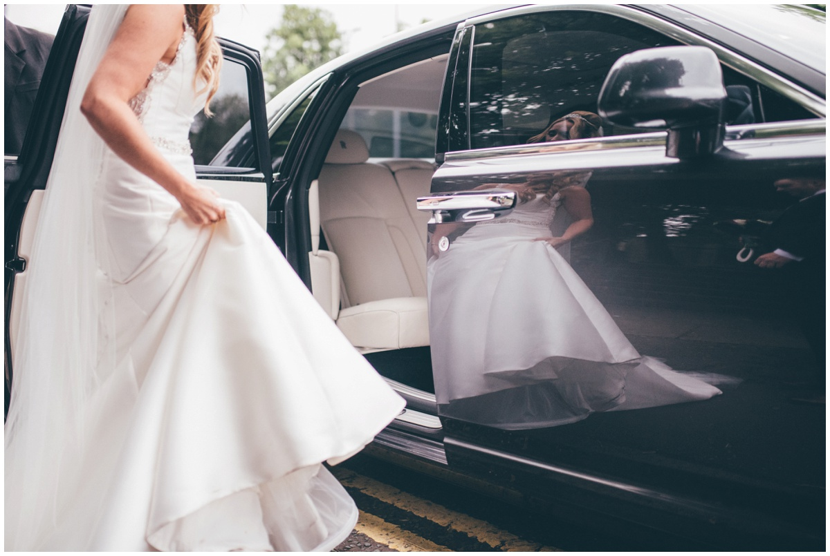 The bride's beautiful reflection in her wedding car outside their wedding venue at Willington Hall in Cheshire.