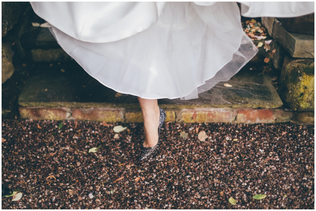 The bride takes a step in her beautiful grey Jimmy Choo bridal shoes.