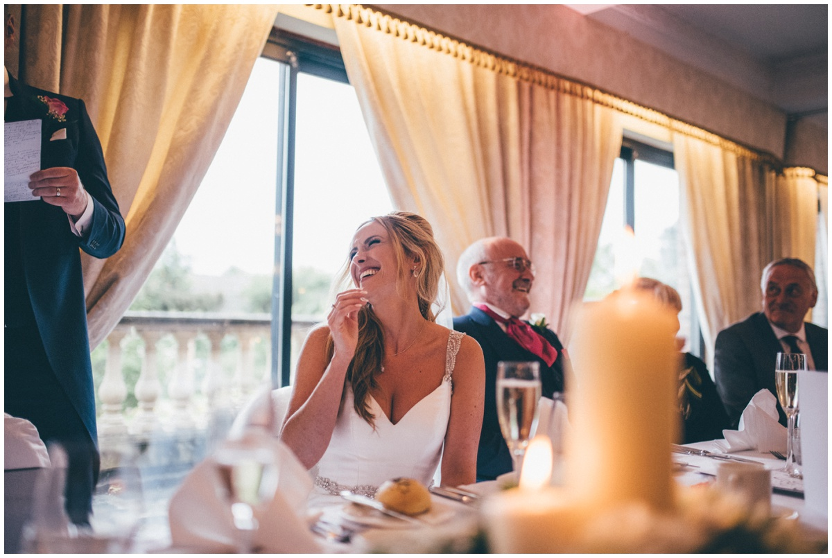Bride laughs at her new husband's speech