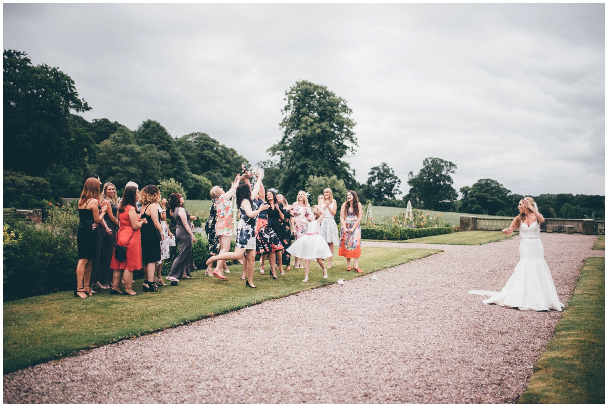 The bride tosses her bouquet at Willington Hall in Cheshire