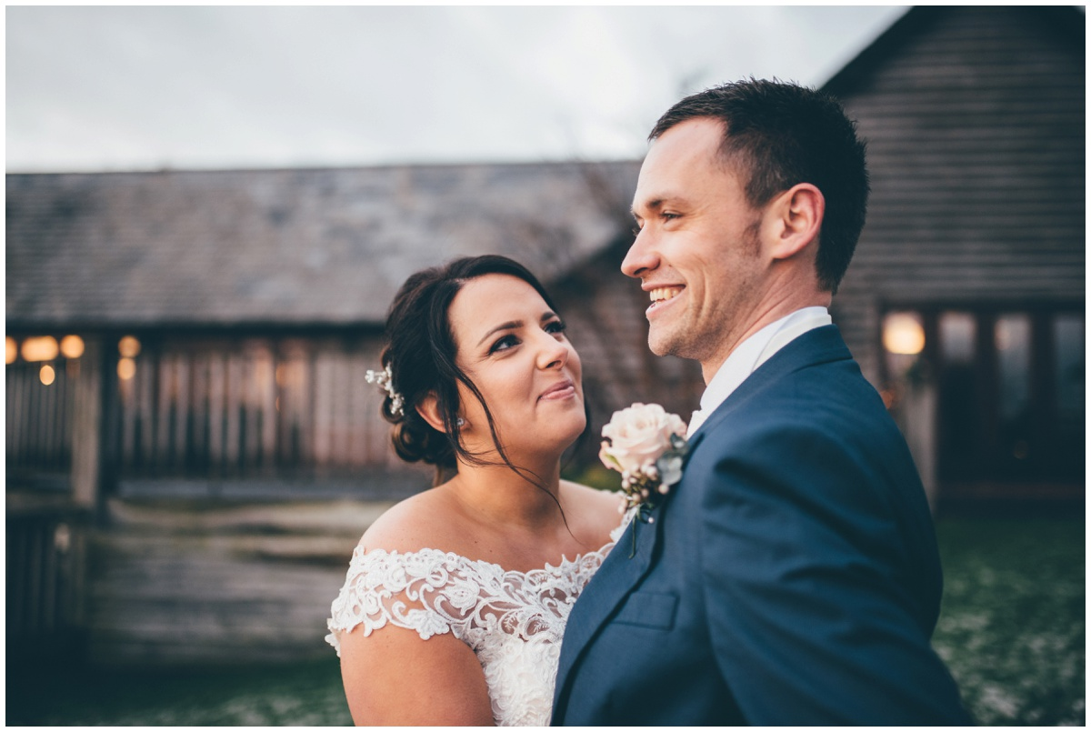 The beautiful Cheshire bride gazes lovingly at her new husband on their wedding day.