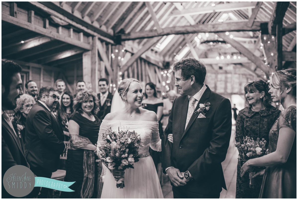 The beautiful bride is walked down the aisle by her uncle at Bassmead Manor.