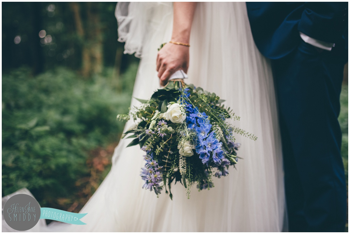 The bride's stunning wild wedding bouquet at Bassmead Manor in Cambridgeshire.