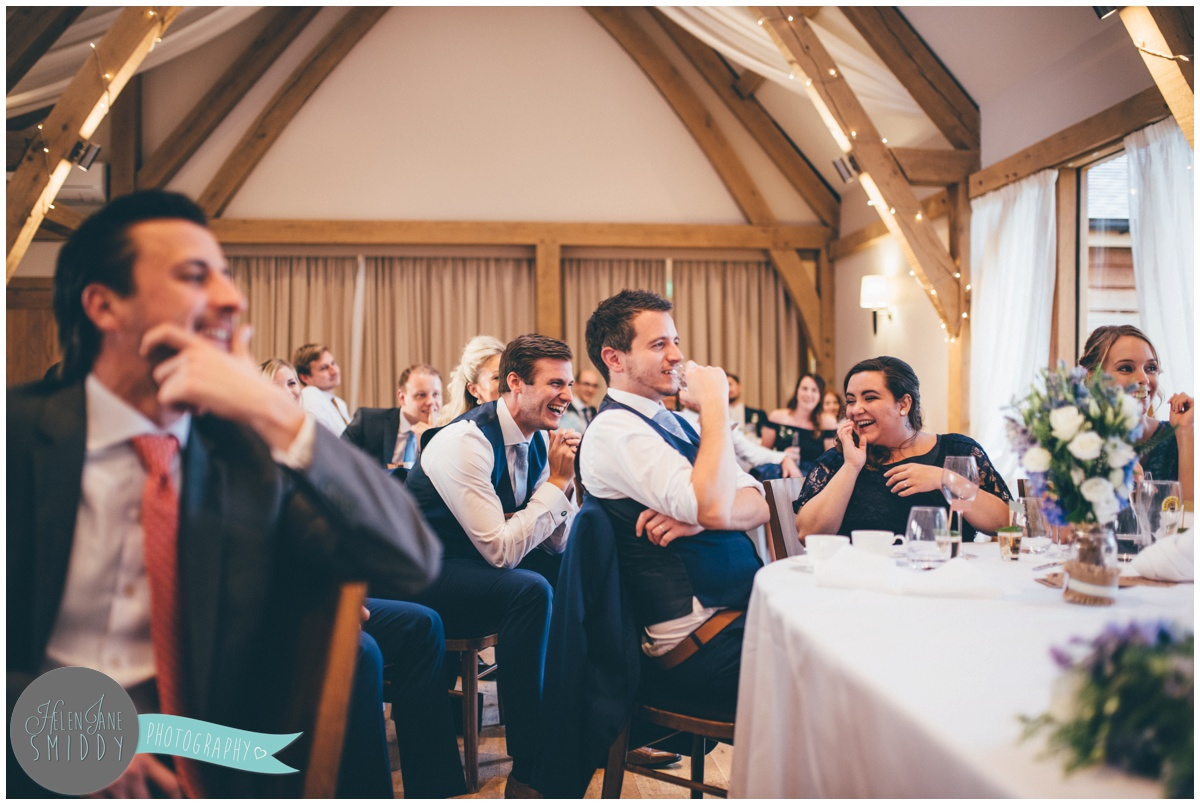Guests enjoy the Wedding speeches at Bassmead Manor wedding barns.