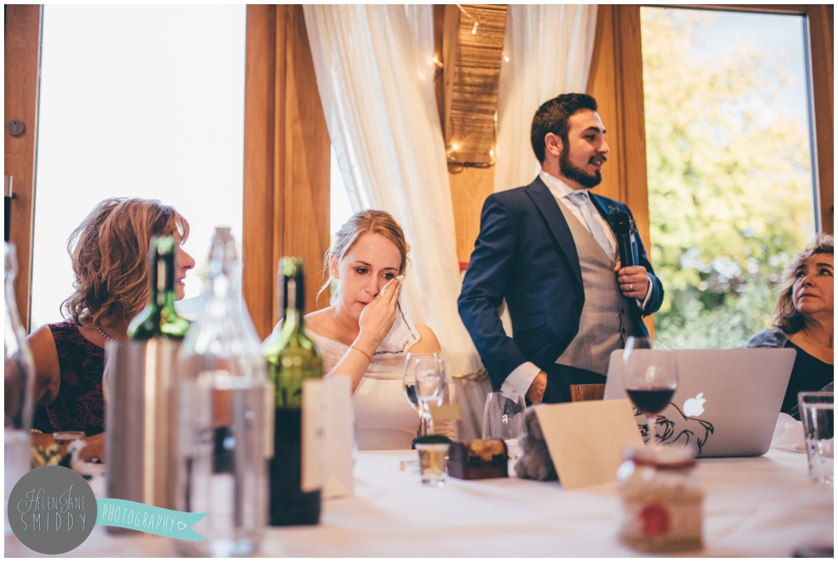 The bride tears up during the Wedding speeches at Bassmead Manor wedding barns.