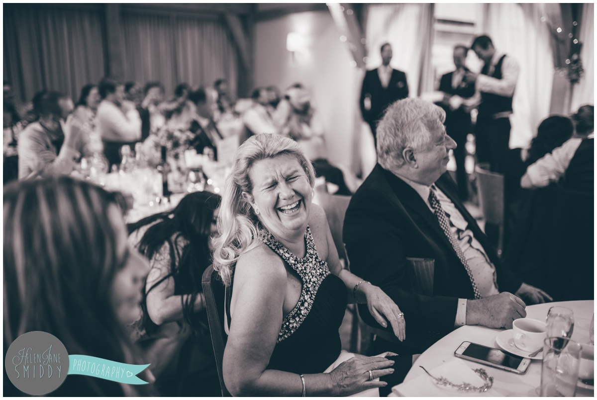 Guest hysterically laughing during a Wedding speeches at Bassmead Manor wedding barns.