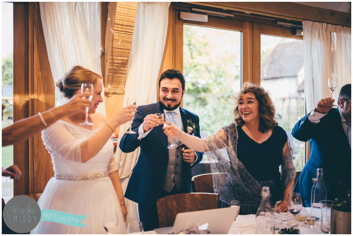 Cheers at Wedding speeches at Bassmead Manor wedding barns.