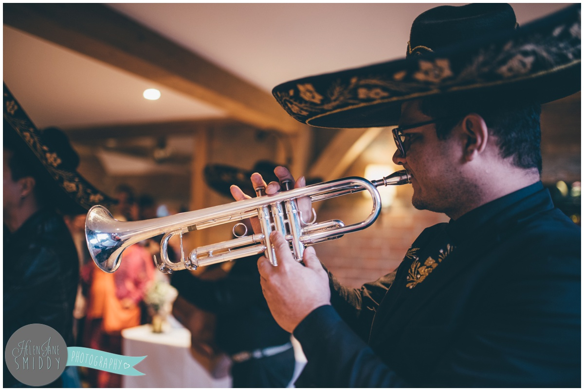 Guests love the Mariachi band surprise at the wedding reception in Cambridgeshire.