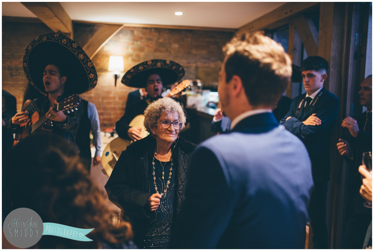 The groom's grandma enjoys the evening wedding reception with the guests.