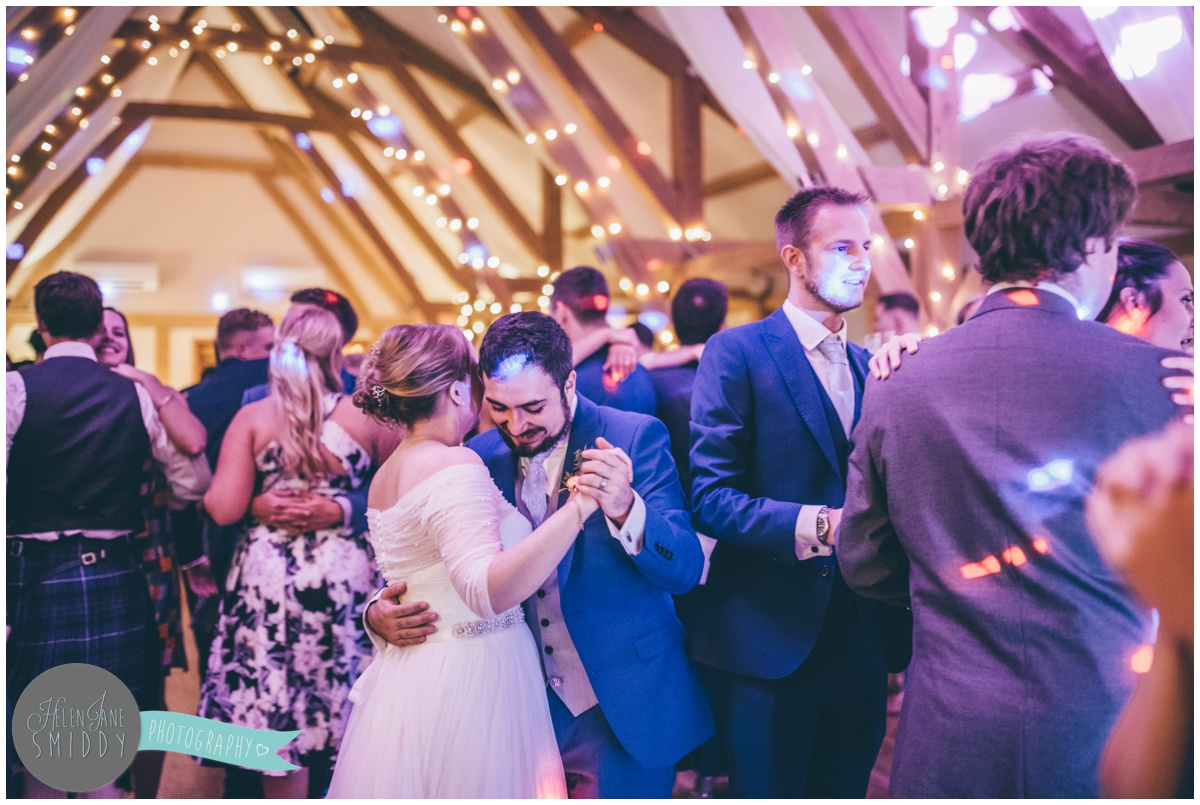 Bride and groom share a dance with their guests at Bassmead Manor Barns.