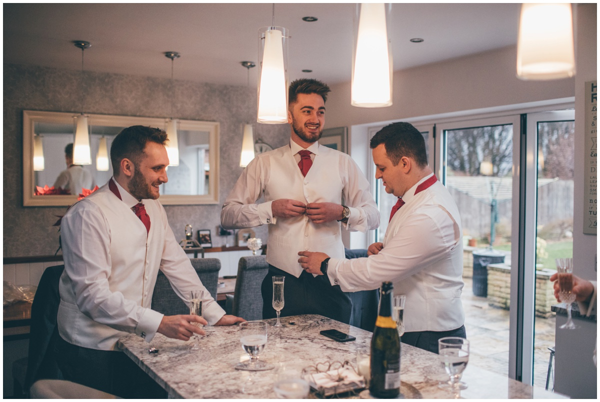 The groomsmen finish getting themselves ready for the Big Day.