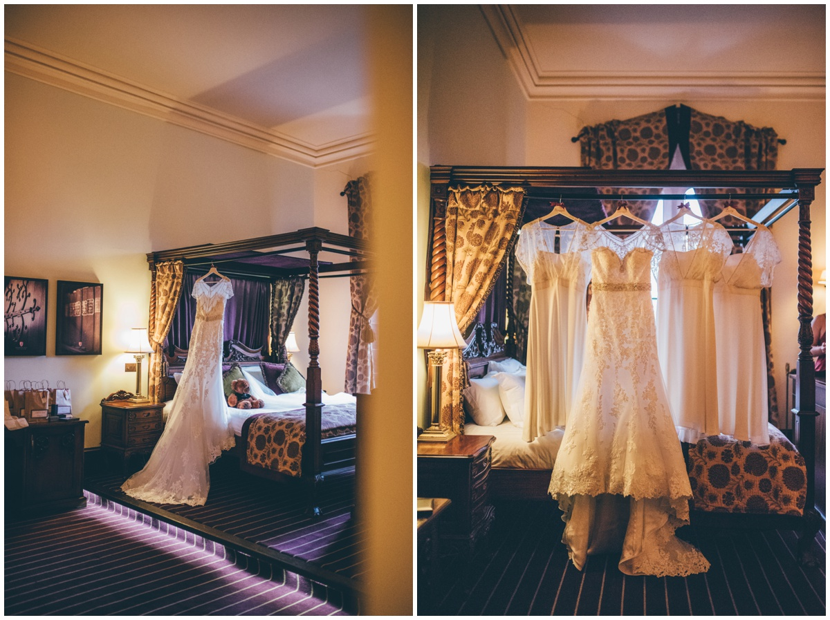 The bride's beautiful wedding gown and bridesmaid dresses hung up at Peckforton Castle.