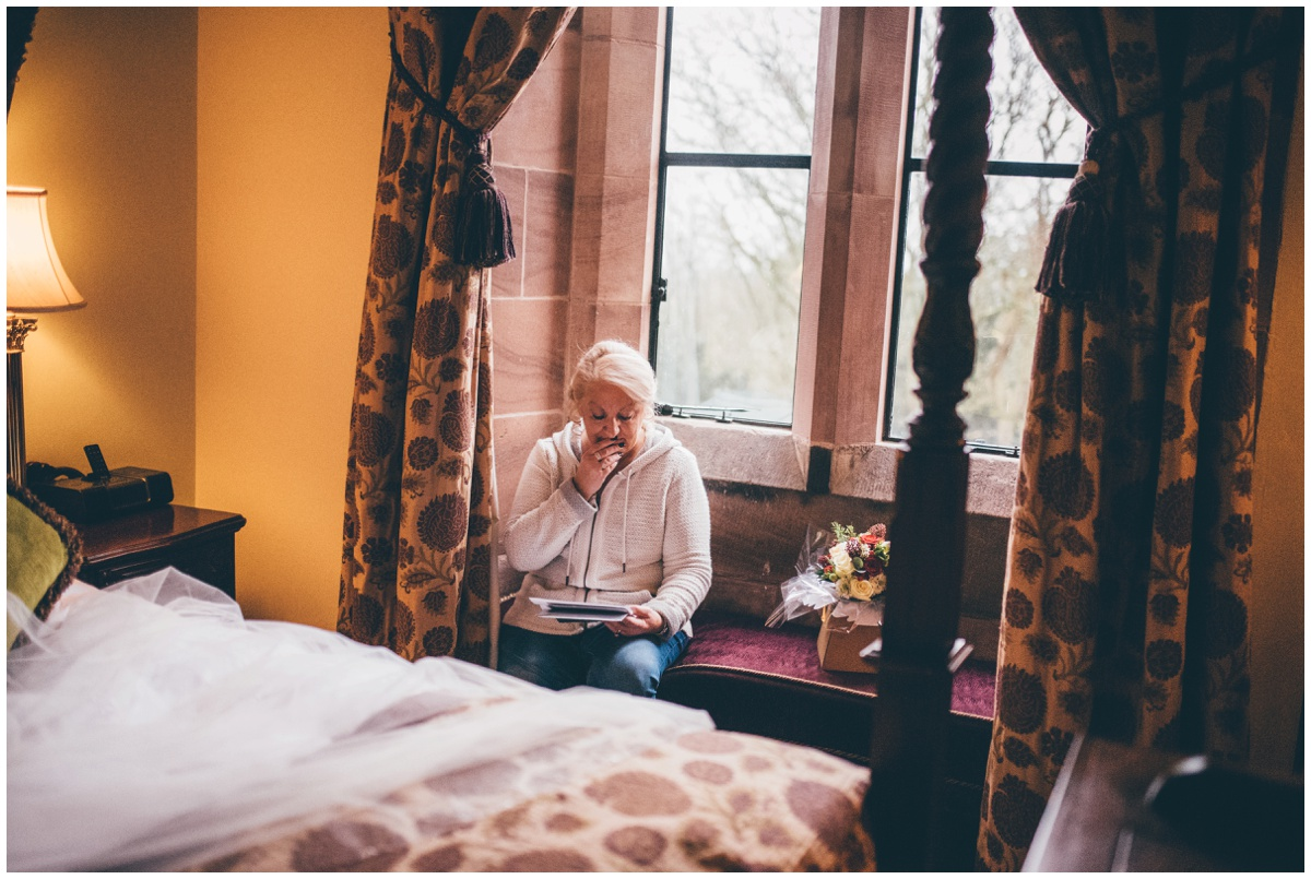 Groom's mother read beautiful card on the wedding morning at Peckforton Castle.