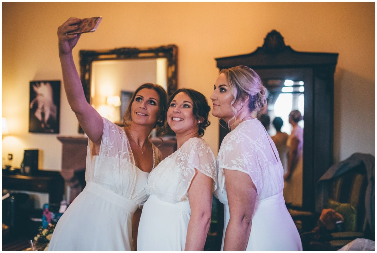 Bridesmaids take a selfie at Peckforton Castle.