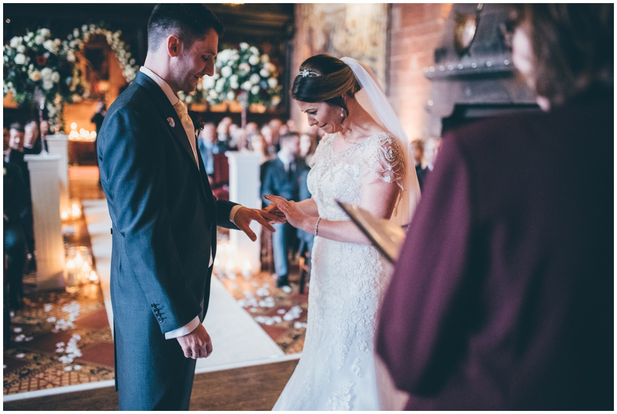 The couple exchange rings during their fairytale wedding.