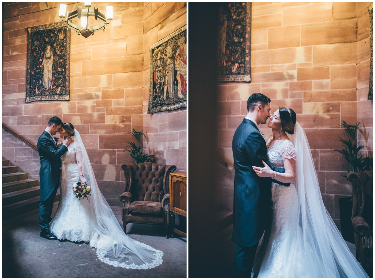 Beautiful bridal portraits in the corridors at Peckforton Castle.